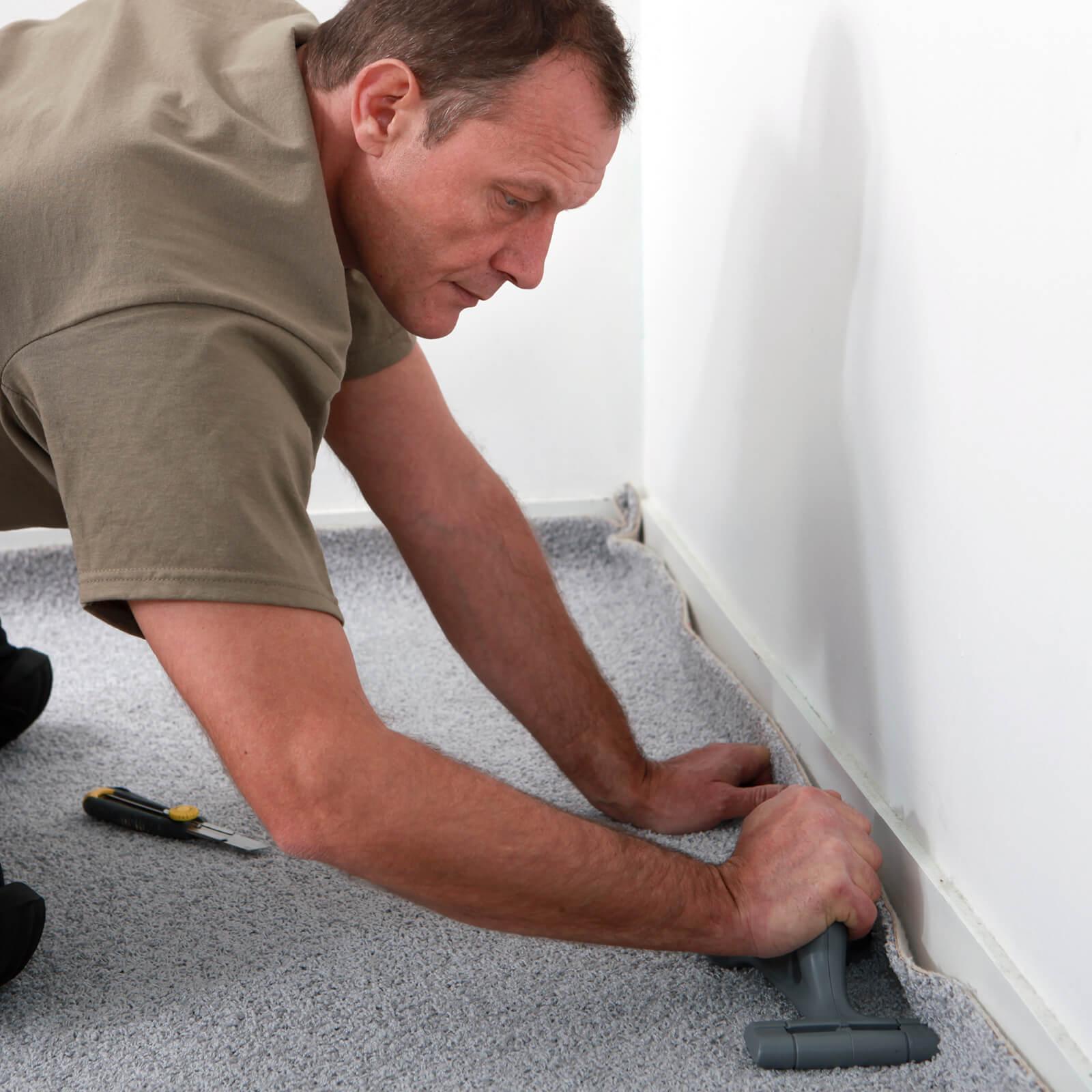 man installing carpet | Great Floors
